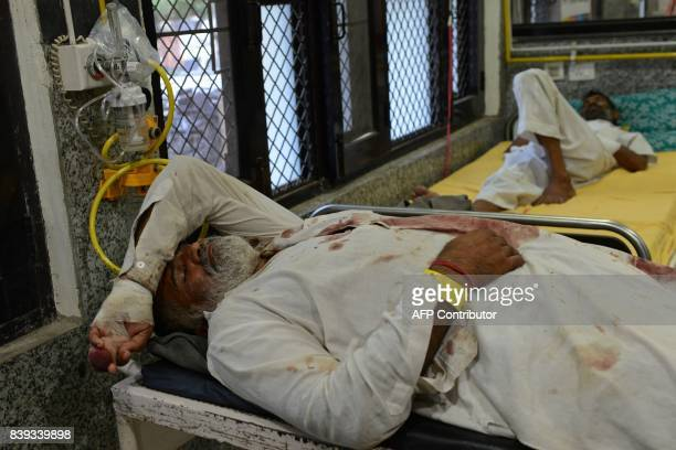 Injured followers of religious leader Gurmeet Ram Rahim Singh are seen after receiving treatment at the civil hospital in Panchkula on August 26 2017...