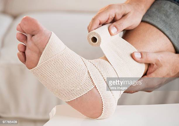 injured foot - sprain stock pictures, royalty-free photos & images