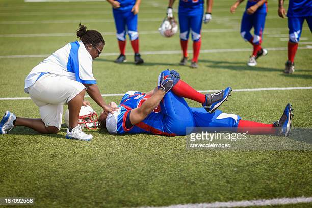 injured football player - physical injury stock pictures, royalty-free photos & images