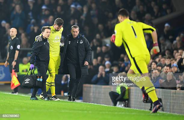 Injured goalkeeper Maarten Stekelenburg of Everton is replaced by substitute Joel Robles of Everton during the Premier League match between Everton...