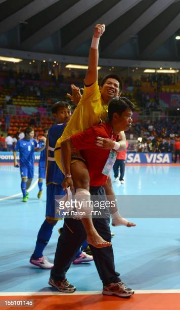 Injured goalkeeper Prakit Dankhunthod of Thailand celebrates after winning the FIFA Futsal World Cup Group A match between Thailand and Costa Rica at...