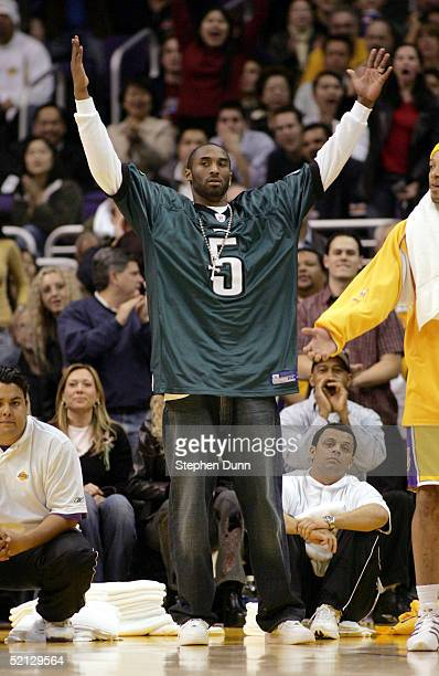 b7281bc899a Injured guard Kobe Bryant of the Los Angeles Lakers wears an NFL jersey of  quarterback Donovan