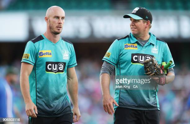 Injured Heat player Chris Lynn looks on during the Big Bash League match between the Sydney Sixers and the Brisbane Heat at Sydney Cricket Ground on...