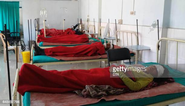 Injured Indian patients receive treatment at a hospital in Nongstoin some 80kms west of Shillong on February 26 after a traffic accident in the...