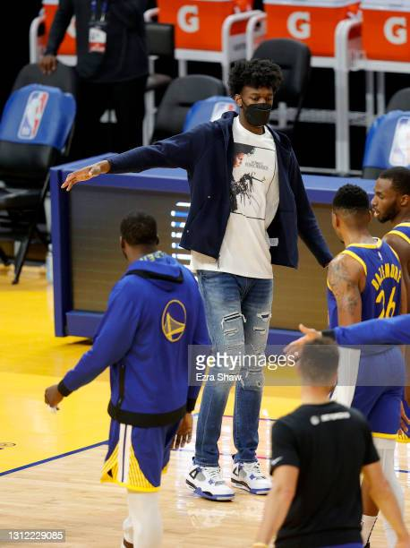 Injured James Wiseman of the Golden State Warriors high fives teammates during a time out of their game against the Denver Nuggets at Chase Center on...
