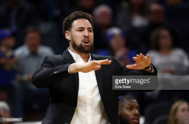 Injured Klay Thompson of the Golden State Warriors reacts on the bench after the Warriors made a basket against the Oklahoma City Thunder at Chase...