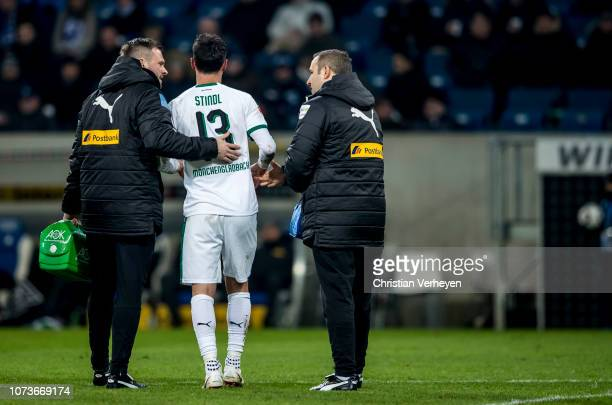 Injured Lars Stindl of Borussia Moenchengladbach leave the pitch during the Bundesliga match between TSG 1899 Hoffenheim and Borussia...