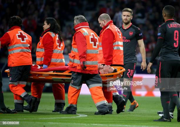 Injured Laurent Koscielny of Arsenal leaves the pitch on a stretcher during the UEFA Europa League Semi Final second leg match between Atletico...