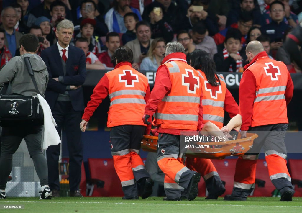 Injured, Laurent Koscielny of Arsenal leaves the pitch on a stretcher in front of coach of Arsenal Arsene Wenger during the UEFA Europa League Semi Final second leg match between Atletico Madrid and Arsenal FC at Estadio Wanda Metropolitano on May 3, 2018 in Madrid, Spain.