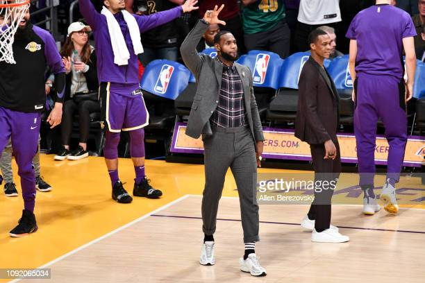 Injured LeBron James cheers on his teammates during a basketball game between the Los Angeles Lakers and the Detroit Pistons at Staples Center on...