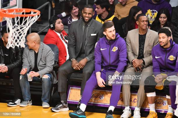Injured LeBron James watches from the bench during a basketball game between the Los Angeles Lakers and the Chicago Bulls at Staples Center on...