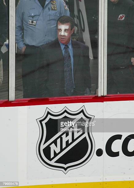 Injured linesman Pat Dapuzzo watches the game between the New York Islanders and the New Jersey Devils at the Prudential Center February 23 2008 in...