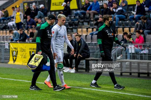 Injured Louis Jordan Beyer of Borussia Moenchengladbach leaves the pitch during the pre-season friendly match between VVV-Venlo and Borussia...
