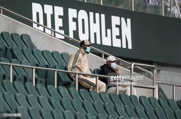 Injured Marcus Thuram and Alassane Plea of Borussia Moenchengladbach are seen on the stands during the Bundesliga match between Borussia...
