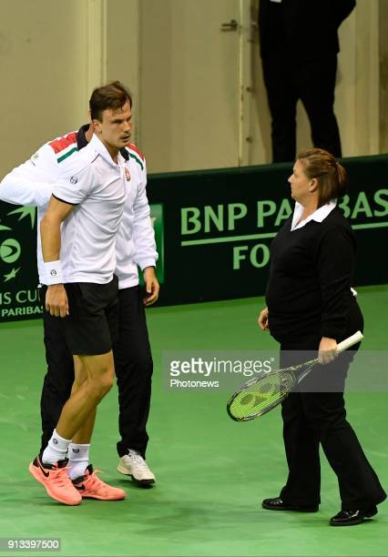 injured Marton Fucsovics vs Ruben Bemelmans of Belgium pictured during the Davis Cup World Group first round match between Belgium and Hungary on...