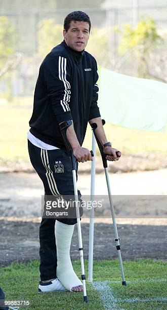 Injured Michael Ballack watches his team during the German National Team training session at Verdura Golf Spa Resort on May 18 2010 in Sciacca Italy
