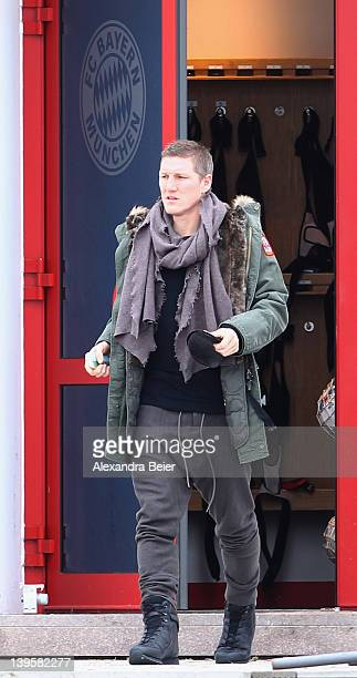 Injured midfielder Bastian Schweinsteiger of Bayern Muenchen leaves the training ground before the team's training session on February 23, 2012 in...