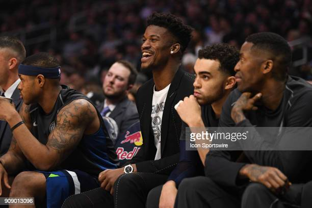 Injured Minnesota Timberwolves Guard Jimmy Butler smiles during an NBA game between the Minnesota Timberwolves and the Los Angeles Clippers on...