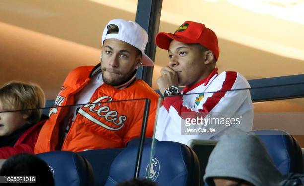 Injured Neymar Jr and Kylian Mbappe of PSG attend from the stands the french Ligue 1 match between Paris SaintGermain and Toulouse FC at Parc des...