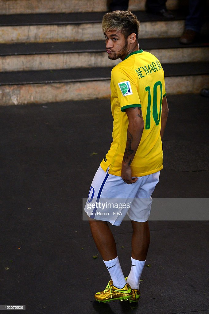 Injured Neymar of Brazil walks off the pitch after the 2014 FIFA World Cup Brazil 3rd Place Playoff match between Brazil and Netherlands at Estadio Nacional on July 12, 2014 in Brasilia, Brazil.
