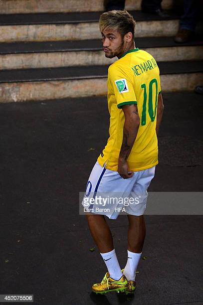 Injured Neymar of Brazil walks off the pitch after the 2014 FIFA World Cup Brazil 3rd Place Playoff match between Brazil and Netherlands at Estadio...