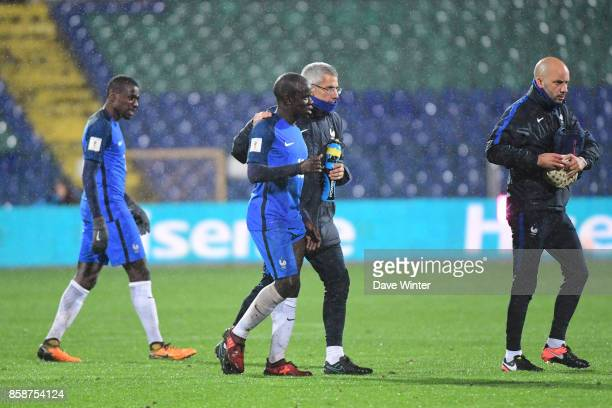 Injured Ngolo Kante of France is accompanied off the pitch by France team doctor Franck Le Gall during the Fifa 2018 World Cup qualifying match...