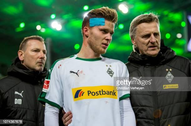 Injured Nico Elvedi of Borussia Moenchengladbach leaves the pitch during the Bundesliga match between Borussia Moenchengladbach and 1FC Nuernberg at...