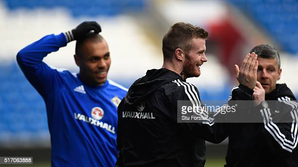 Injured Northern Ireland player Chris Brunt shares a joke with team mates during training ahead of their match agaisnt Wales at Cardiff City stadium...