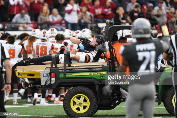 injured OSU quarterback Jake Luton gives a thumbs up as he is carted off the field during the game between the Oregon State Beavers and the...