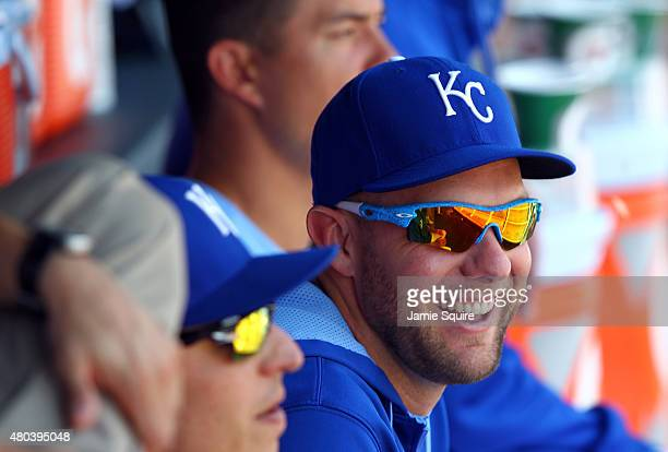 Injured outfielder Alex Gordon of the Kansas City Royals watches from the dugout during the game against the Toronto Blue Jays at Kauffman Stadium on...