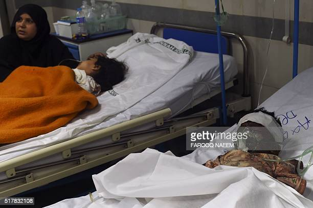 Injured Pakistani child victims of a suicide blast rest in a hospital in Lahore on March 28 2016 A suicide bomber who attacked a park thronging with...