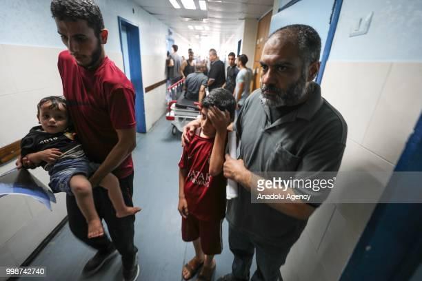 Injured Palestinians wait to receive treatment at alShifa hospital after Israeli fighter jets pounded Al Katiba region in Gaza City Gaza on July 14...