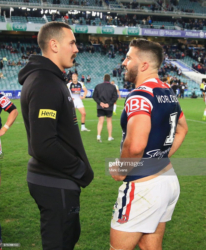 Injured Panthers player Reagan Campbell-Gillard talks to James Tedesco of the Roosters after the round 15 NRL match between the Sydney Roosters and the Penrith Panthers at Allianz Stadium on June 15, 2018 in Sydney, Australia.