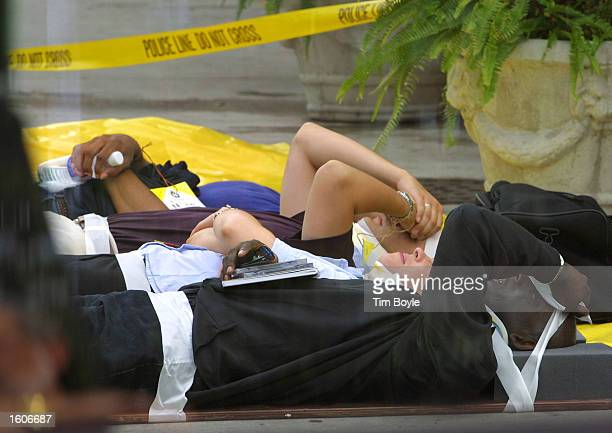Injured passengers wait for treatment in a triage area after being evacuated from two commuter trains that collided August 3 2001 in Chicago An...