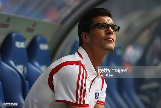 Injured Paul Scharner of Hamburg is seen on the bench prior to the Bundesliga match between Hamburger SV and 1 FC Nuernberg at Imtech Arena on August...