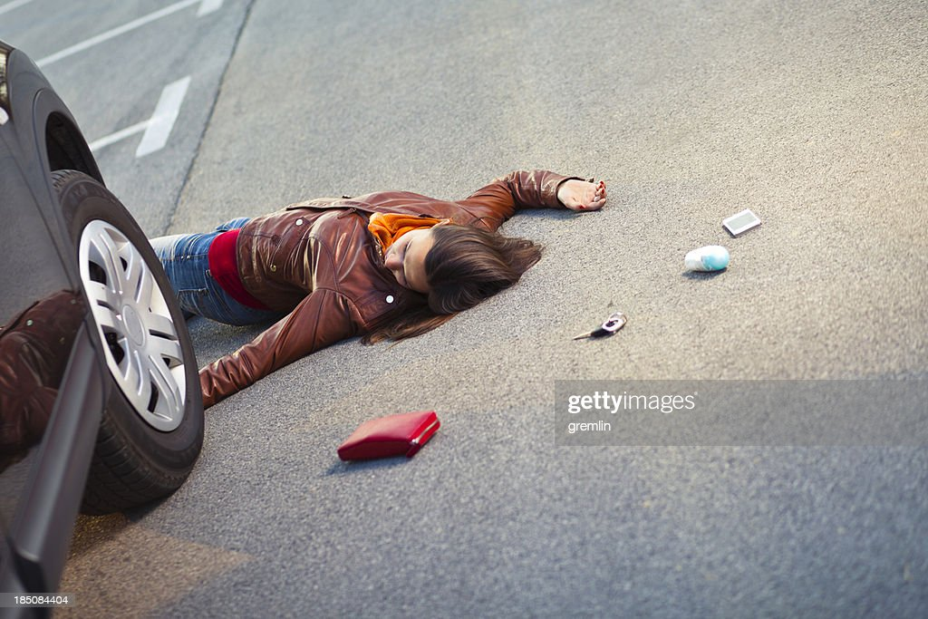 Injured pedestrian in a car accident : Stock Photo