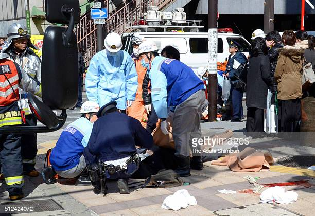 Injured peole receive medical treatment before being carried by a stretcher after a car crashed into pedestrians at Umeda area on February 25 2016 in...