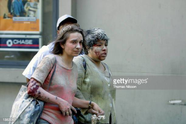 Injured people flee the World Trade Center area after the south tower collapsed September 11, 2001 in New York City.