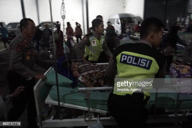 Injured people receive treatment outside a hospital in the quakedevastated area after an earthquake measuring 69 on the Richter Scale rocked Banyumas...