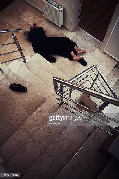Injured person lying at the bottom of a winding stairwell