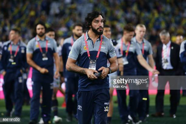 Injured player Johnathan Thurston of the Cowboys looks dejected and walks with Cowboys players after the 2017 NRL Grand Final match between the...