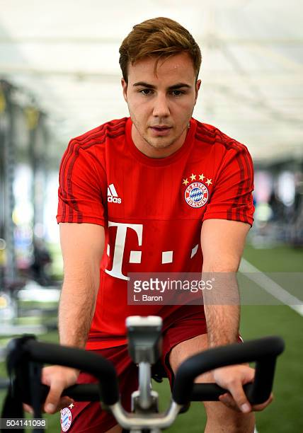 Injured player Mario Goetze trains on a spinning bike during a training session at day four of the Bayern Muenchen training camp at Aspire Academy on...
