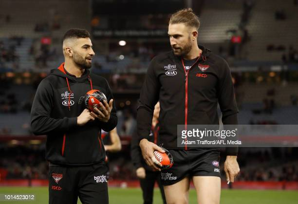 Injured players Adam Saad and Cale Hooker of the Bombers chat during the 2018 AFL round 21 match between the Essendon Bombers and the St Kilda Saints...