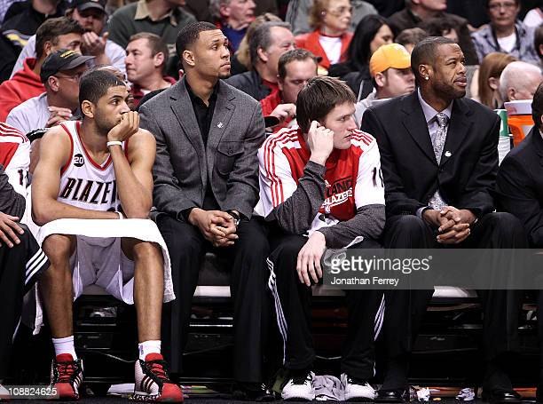 Injured players Brandon Roy and Marcus Camby of the Portland Trail Blazers sit on the bench and watch the game against the San Antonio Spurs on...