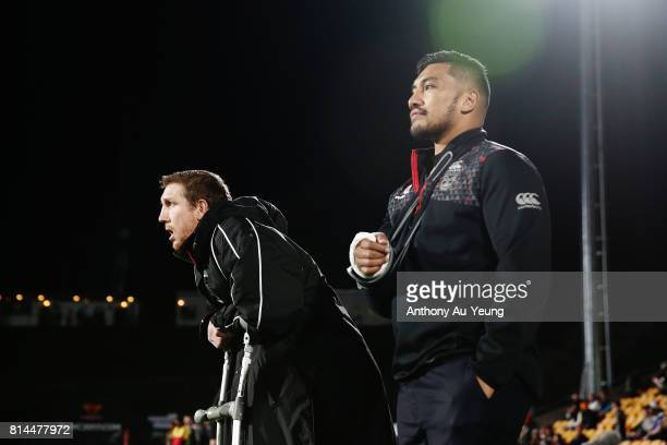 Injured players Ryan Hoffman and Albert Vete of the Warriors look on prior to the round 19 NRL match between the New Zealand Warriors and the Penrith...