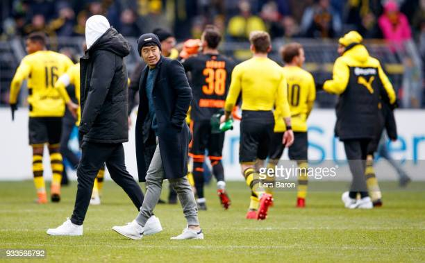Injured players Shinji Kagawa of Dortmund is seen after the Bundesliga match between Borussia Dortmund and Hannover 96 at Signal Iduna Park on March...