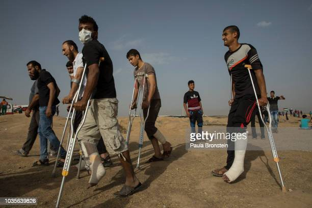 Injured protesters are seen at the site near the IsraelGaza border on May 252018 in Gaza city Gaza strip At least 110 Palestinians were killed...