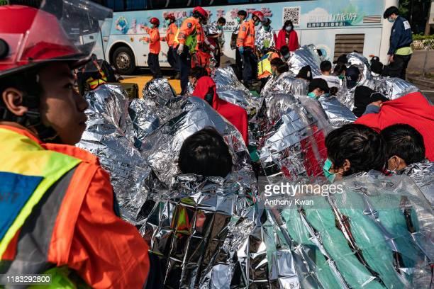 Injured protesters wait to be transferred to a hospital at The Hong Kong Polytechnic University on November 19 2019 in Hong Kong China Antigovernment...