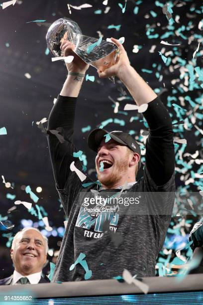 Injured quarterback Carson Wentz of the Philadelphia Eagles holds the Lombardi Trophy after defeating the New England Patriots 4133 in Super Bowl LII...