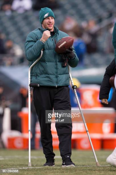 Injured quarterback Carson Wentz of the Philadelphia Eagles watches warmups before the game against the Dallas Cowboys at Lincoln Financial Field on...